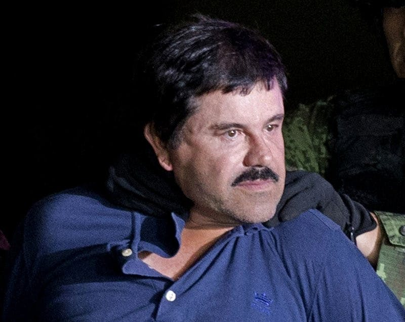 "In this Jan. 8, 2016 file photo, drug lord Joaquin ""El Chapo"" Guzman is made to face the media in Mexico City as he is escorted by Mexican soldiers following his recapture six months after escaping from a maximum security prison. The notorious Mexican drug lord was convicted of drug-trafficking charges, Tuesday, Feb. 12 2019, in federal court in New York. (AP Photo/Eduardo Verdugo, File)"