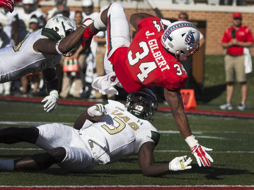 Running back James Gilbert jumps over redshirt sophomore safety Will Dawkins in the third quarter against UAB on Sept. 9 at Scheumann Stadium. Grace Hollars, DN
