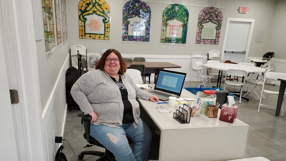 Toni Werner sits at a desk at Warm a Heart ministry in Waterloo. Werner is a 1999 Ball State alumna who taught for 23 years before becoming director of the ministry. Warm a Heart ministry, Photo Courtesy