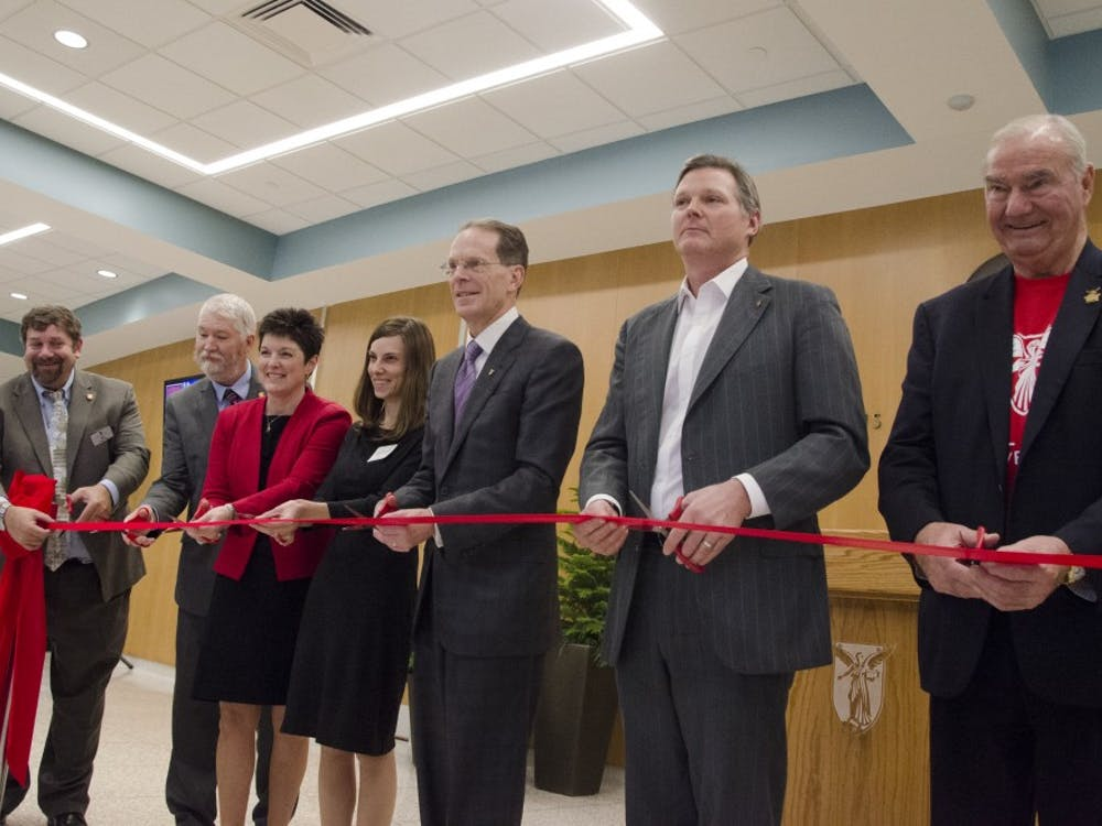 University officials cut a ribbon at the reopening of the John R. Emens auditorium Nov. 10. Andrew Smith, DN Photo