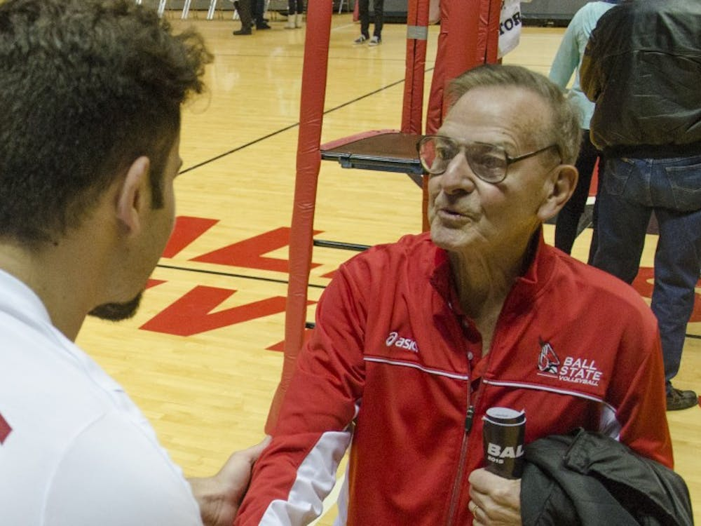 Junior setter Hiago Garchet talks to coach Don Shondell The Ball State men's volleyball team signs posters for fans after the game against Penn State on Jan. 16 at Worthen Arena. DN PHOTO BREANNA DAUGHERTY