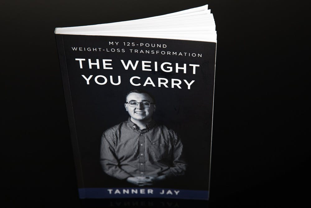 <p>&quot;The Weight You Carry&quot; by Tanner Jay, a 2020 graduate of Ball State University, was released in July 2020. Jay raised more than $5000 for the book through his IndieGoGo campaign. <strong>Jacob Musselman, DN Illustration</strong></p>