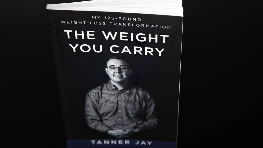 """""""The Weight You Carry"""" by Tanner Jay, a 2020 graduate of Ball State University, was released in July 2020. Jay raised more than $5000 for the book through his IndieGoGo campaign. Jacob Musselman, DN Illustration"""