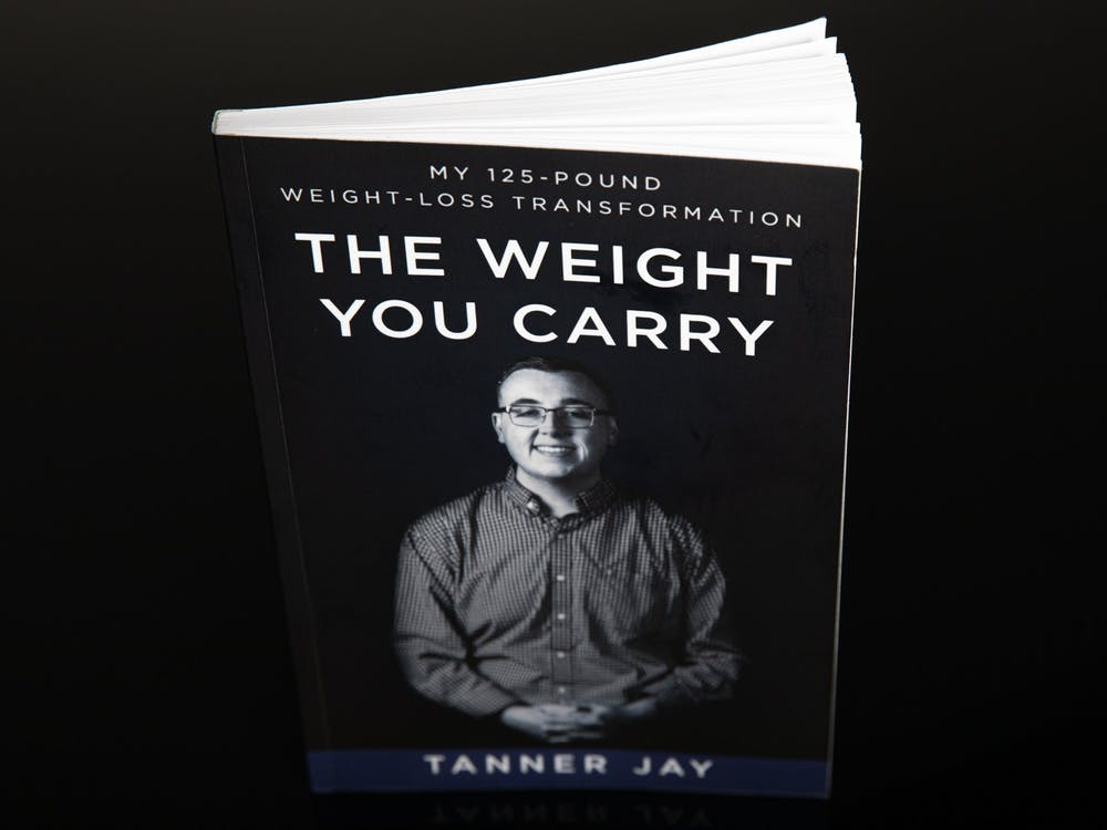 """The Weight You Carry"" by Tanner Jay, a 2020 graduate of Ball State University, was released in July 2020. Jay raised more than $5000 for the book through his IndieGoGo campaign. Jacob Musselman, DN Illustration"