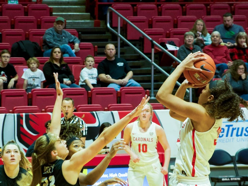 Junior Forward, Oshlynn Brown(32) , fades away on a two point attempt against Butler on Nov. 23, 2019 at John E. Worthen Arena. Brown finished the game with 10 points in a 74-70 win. Omari Smith, DN