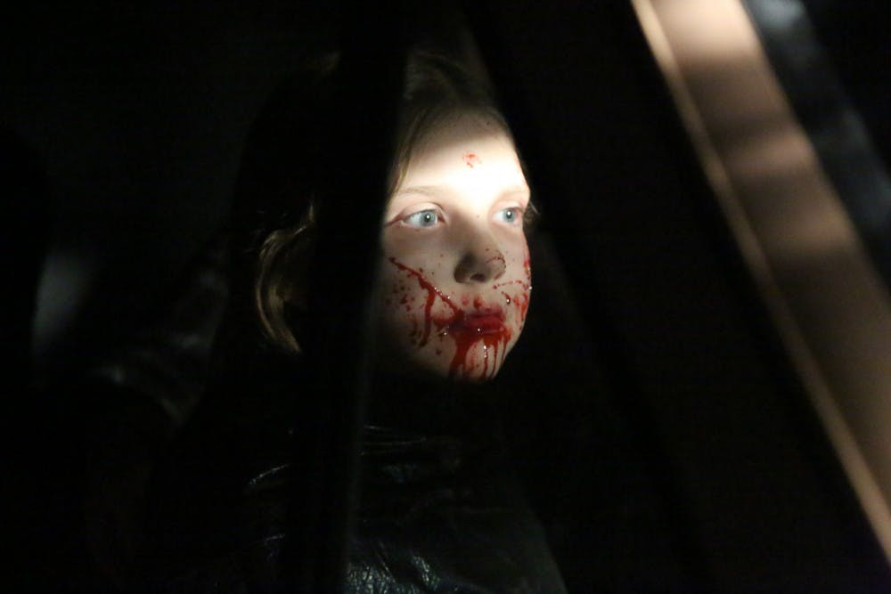 "Nadia Fancher, 9, has her face covered with fake blood during the filming of ""Popsy."" Ball State alumnus and director Jac Kessler said he cast Nadia because of her ability to take direction and their mutual love for Alice Cooper and horror. Jac Kessler, Photo Provided"