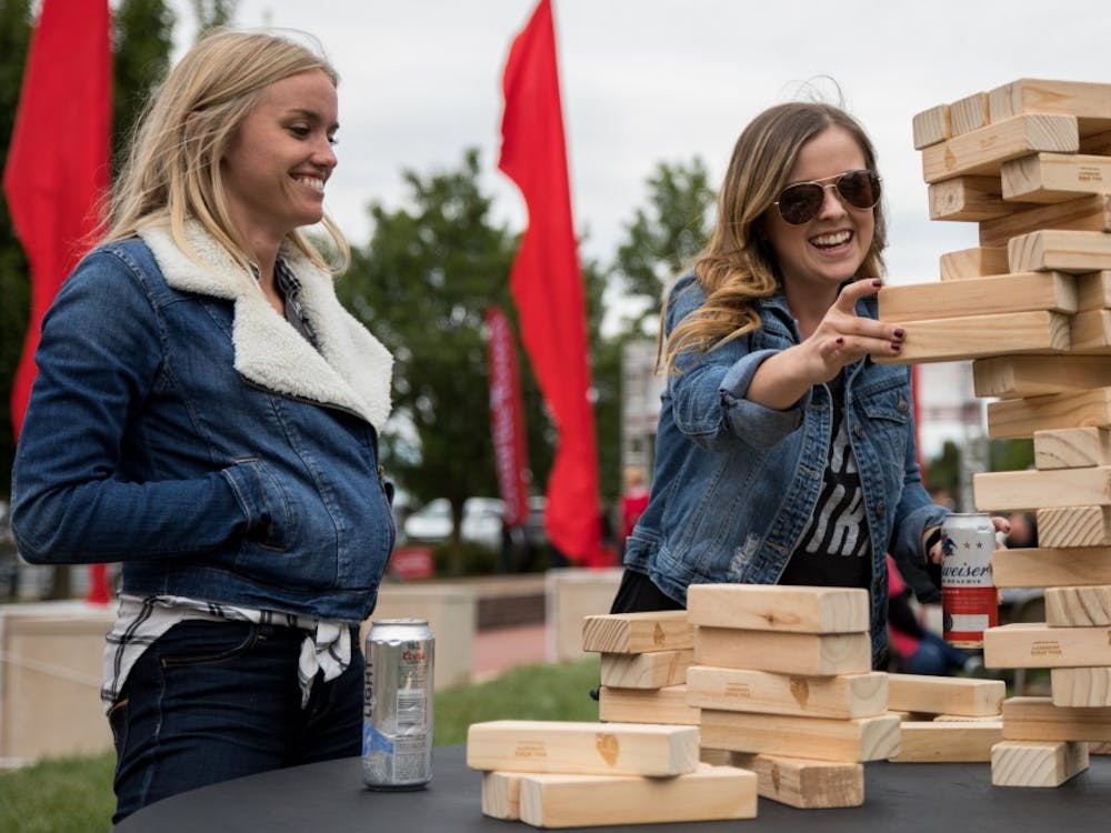 Kristen Olson and Taylor West play Jenga in Charlie Town Sept. 22, 2018, before Ball State played Western Kentucky in football. Charlie Town is a tailgating opportunity, and takes place before every home football game. Eric Pritchett, DN File