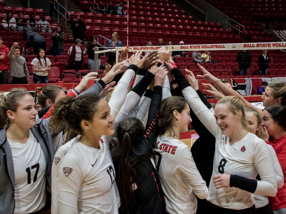 Ball State women's volleyball huddles after defeating Central Michigan in the last game of the regular season Nov. 16, 2019, in John E. Worthen Arena. The Cardinals are 17-11 for the season going into the MAC championship. Eric Pritchett, DN