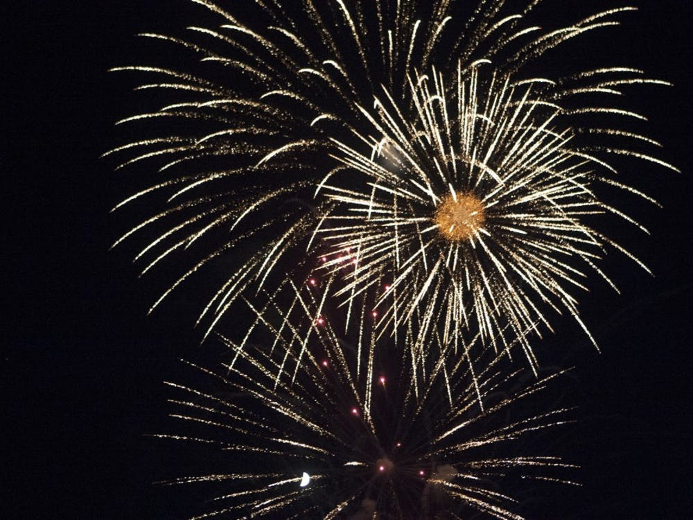 Fireworks light the sky above Yorktown as part of the town's 4th of July celebration. DN PHOTO JORDAN HUFFER
