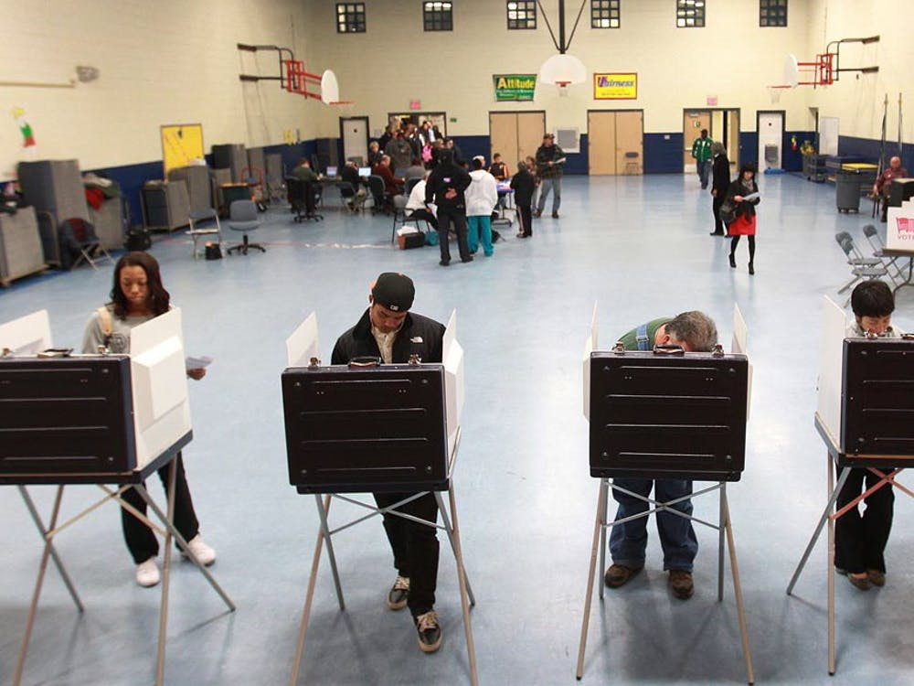 Voters cast their ballots at Kiln Creek Elementary Tuesday, November 6, 2012, in Newport News, Virginia. (Rob Ostermaier/Newport News Daily Press/MCT)