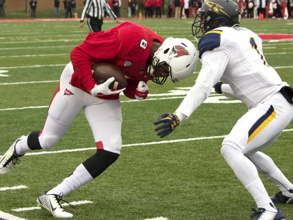 Ball State senior wide receiver Jordan Williams prepares for a tackle during the homecoming game against the University of Toledo on Oct. 3 at Scheumann Stadium. (Grace Ramey)