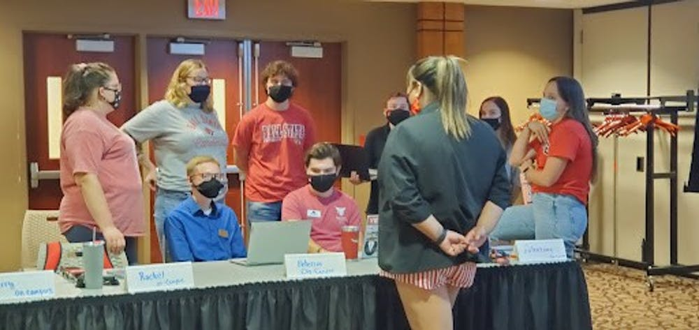 """<p>Student Government Association (SGA) President Tina Nguyen talks with SGA senators at the meeting Sept. 29. Senators discussed upcoming events including a climate strike, the """"Hit the Books Bash"""" and plans for a sexual assualt awareness event. <strong>Nathan Hill, DN</strong></p>"""