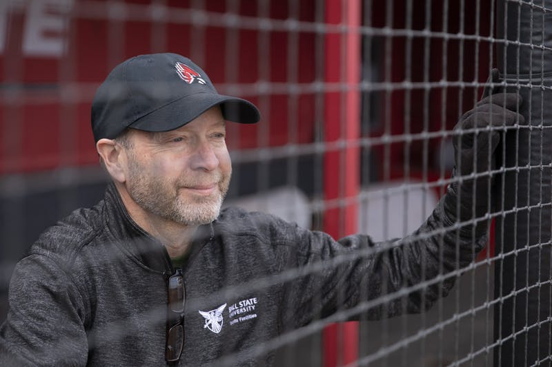 Phil Clay, manager of physical education athletic grounds and facilities supervises looks through the netting of the dugout March 24, 2021, at Ball Diamond at First Merchants Ballpark Complex. Clay is in charge of the facilities for the outside athletic fields including softball, baseball, soccer and field hockey. Jacob Musselman, DN