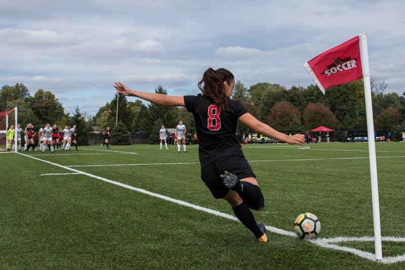 Midfielder Paula Guerrero sends the ball to her Ball State teammates with a corner kick in their game against the University at Buffalo Oct. 14,2018, at Briner Sports Complex. The Cardinals defeated the Bulls 1-0 which put them 5-2-1 in the MAC conference. Eric Pritchett,DN
