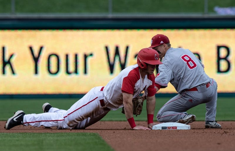 Junior right fielder Ross Messina dives into second base during the third inning at Victory Field in Indianapolis April 23, 2019. Messina was the only Cardinal to have multiple hits in the game. Rebecca Slezak, DN