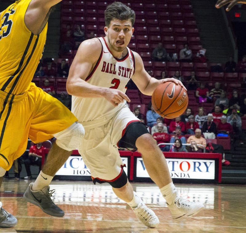 Guard Taylor Persons, pushes his way up the court against Toledo guards Tuesday, Jan. 31 at Worthen Arena in Muncie, IN. Ball State defeated Toledo in a close game, 81-80. Daily News // Grace Hollars