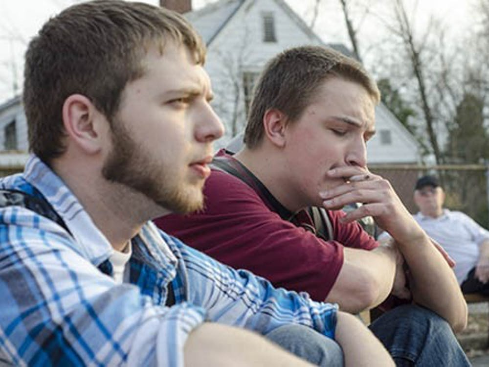 Aaron Huntley takes a drag off of his cigarette while he talks with Nick Solloway. A recent study by Ball State's Global Health Institute showed that Indiana has the seventh highest smoking rate in the nation. DN PHOTO COREY OHLENKAMP