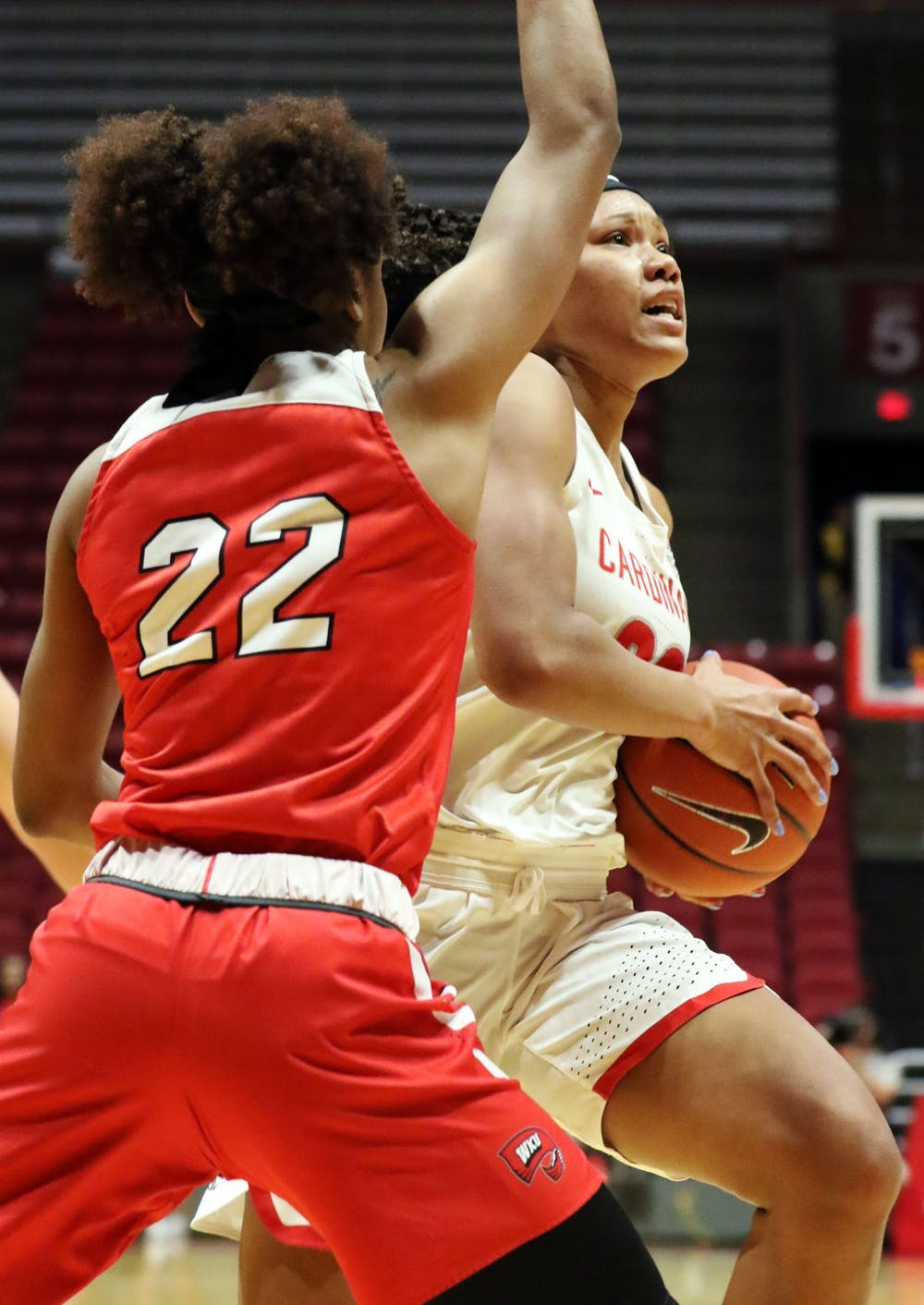 <p>Ball State junior forward Oshlynn Brown drives the ball in while being guarded by Western Kentucky junior guard Sherry Porter during the Cardinals' game against the Hilltoppers Dec. 7, 2019, at John E. Worthen Arena. Brown was Ball States leading scorer with 22 points. <strong>Paige Grider, DN&nbsp;</strong></p>