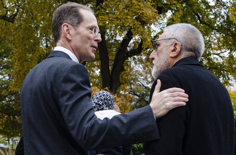 President Geoffrey Mearns thanks Mohammad Saber Bahrami, family physician at Indiana University Health, for attending the vigil at Beneficence Statue was surrounded with people with candle sticks and a memorial speeches, Nov. 2, 2018.  Stephanie Amador, DN