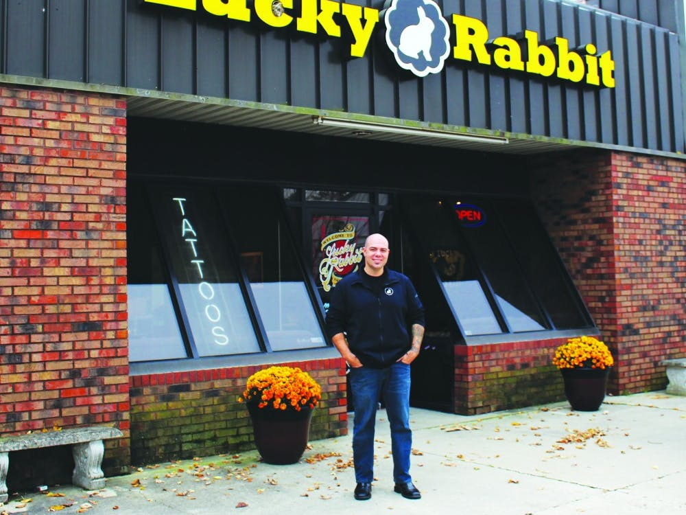Daniel Stewart, the owner of Lucky Rabbit, stands in front of his shop Nov. 5, 2018. Stewart has been a tattoo artist for almost 25 years. Michaela Kelley,DN