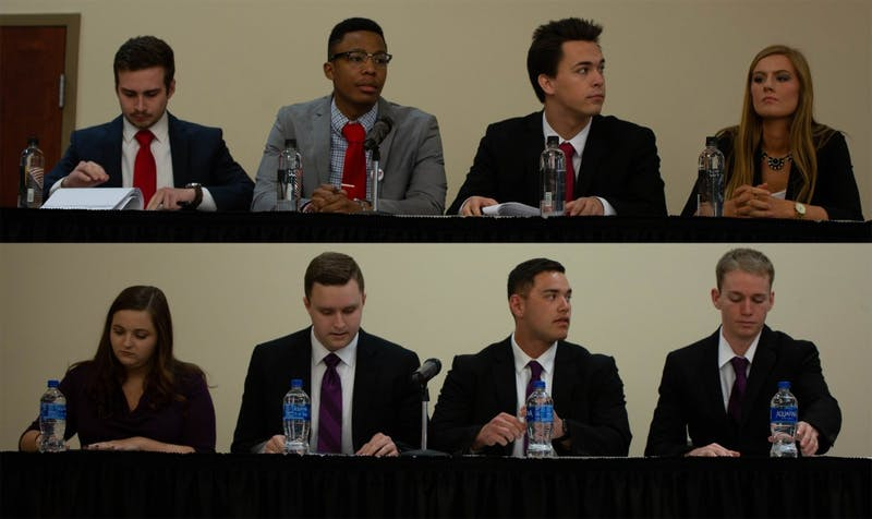 Candidates from the Empower and Elevate slates remain seated during the final All-Slate Debate of the 2019 Student Government Association (SGA) Election March 11, 2019 in the L.A. Pittenger Student Center ballroom. The final round of voting will take place March 18-19, 2019. Scott Fleener, DN