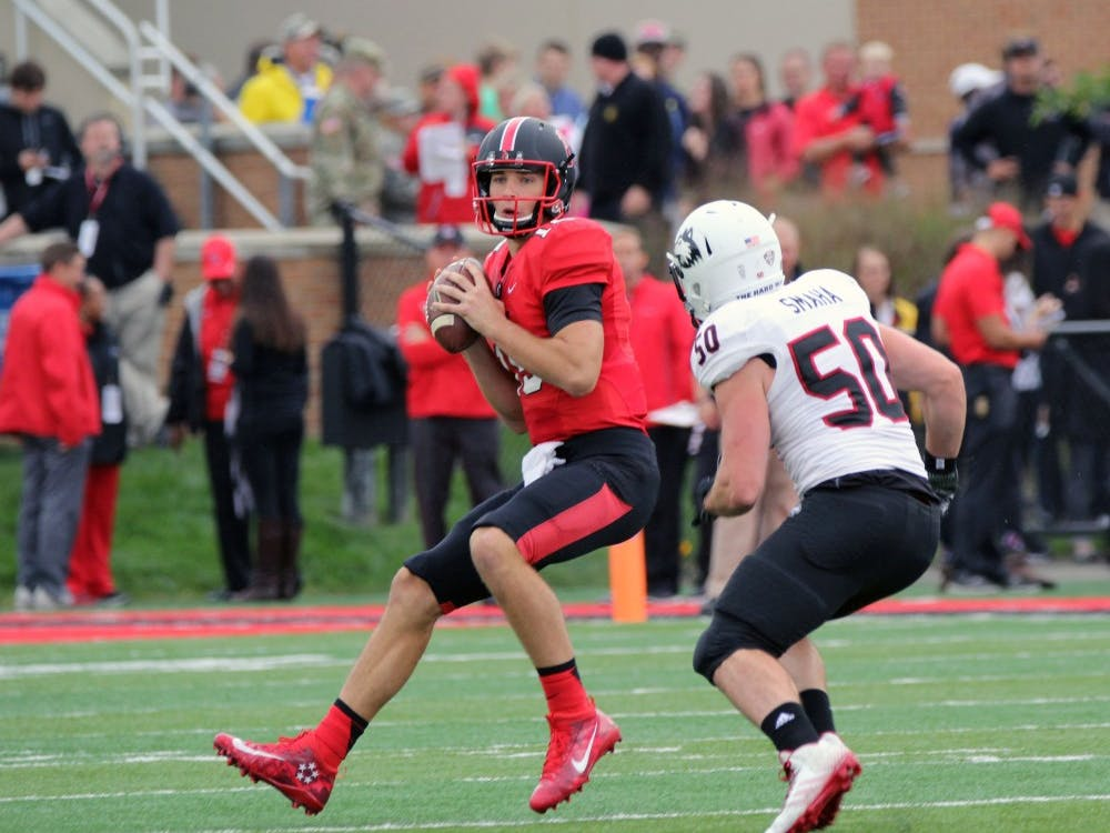 Quarterback Riley Neal looks to pass the ball during the Cardinals' game against Northern Illinois on Oct. 1 in Scheumann Stadium. Ball State lost 31 to 24. Paige Grider// DN File