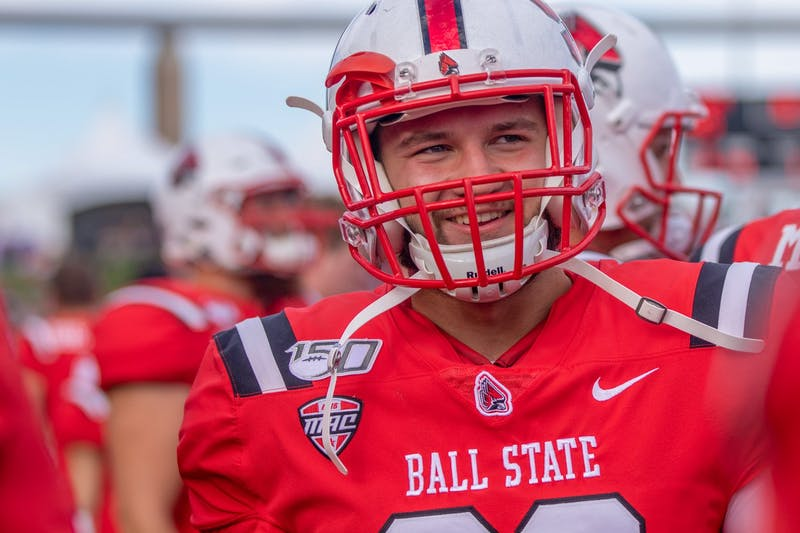 Redshirt freshman Mitchell Carter stands with his teammates Oct. 19, 2019, at Scheumann Stadium. Carter plays fullback for the Ball State Cardinals. Jacob Musselman, DN
