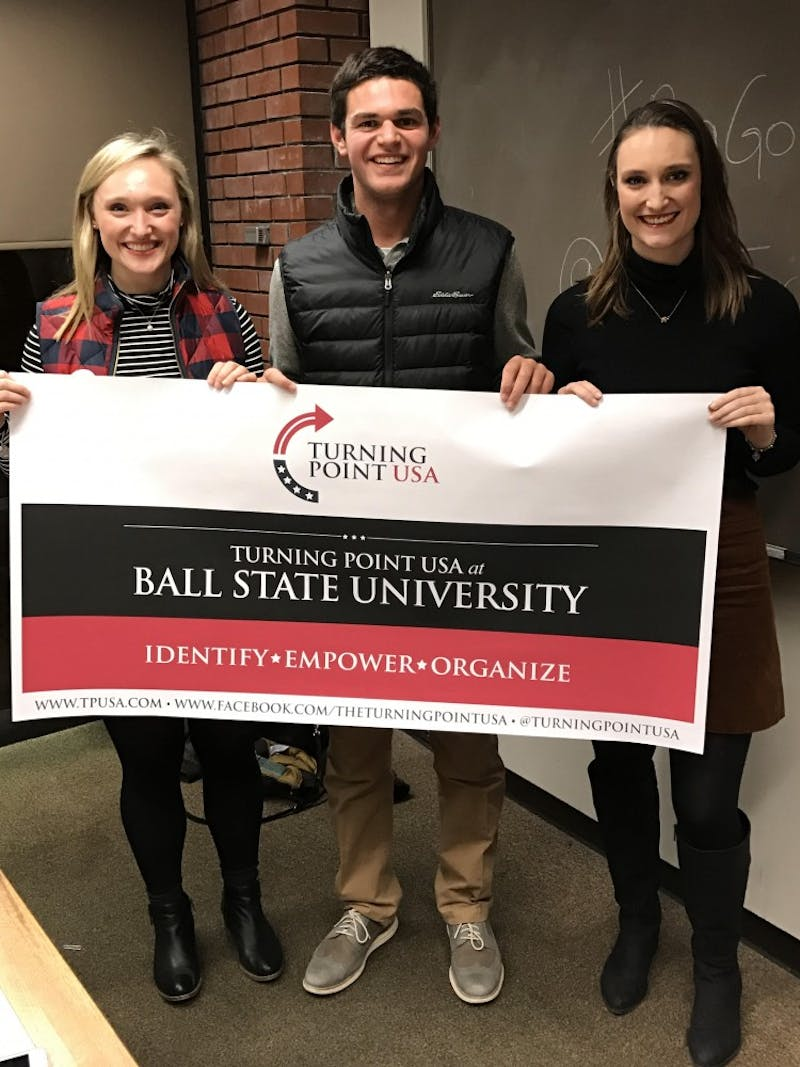 (From left) Caroline Owens, Luke Weise and Merre Owens display the new banner for Turning Point USA. TPUSA is a new club at Ball State that aims to talk about political issues in a civil, nonpartisan manner. Luke Weise // Photo Provided