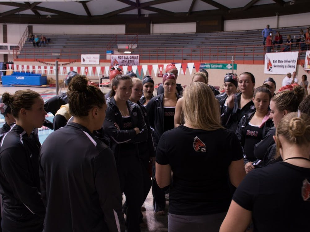 Head coach Kristy Castillo talks to the Ball State Women's swim team before the Red and White meet in the Lewellen Pool on Oct. 8, 2016. The red team won 117-105. Kaiti Sullivan // DN