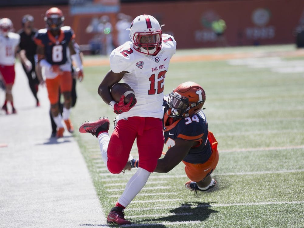 Ball State wide receiver Justin Hall runs down the sideline after a catch against the University of Illinois on Sept. 2, 2017. The true freshman finished the game with two receptions and 36 receiving yards. Robby General, DN