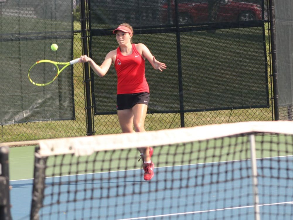 Junior Rebecca Herrington attempts to return the ball to a Detroit Mercy player during the first day of the Hidden Dual Tournament Sept. 22, 2018, at the Cardinal Creek Tennis Center. Herrington won the singles match 6-2, 6-1. Patrick Murphy,DN