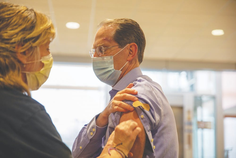 <p>Ball State President Geoffrey Mearns gets his first dose of the Pfizer-BioNTech vaccine March 11, 2021, at IU Ball Memorial Hospital. In an April 1 email, Mearns encouraged members of the student body to receive vaccines now that they are eligible. <strong>Jaden Whiteman, DN File</strong></p>