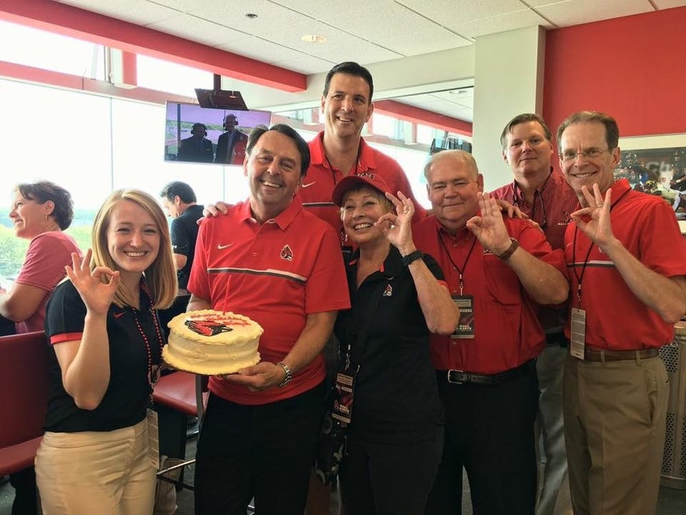 Board of Trustees members (from left) Marlee Jacocks, Wayne Estopinal, Chair Rick Hall, Jean Ann Harcourt, Mike McDaniel, Tom Bracken and President Geoffrey Mearns celebrate Estopinal's birthday at a home football game in the fall of 2017. Estopinal was not only active in the university through the Board of Trustees, but was also an active alumnus in the College of Architecture and Alumni Council. Marlee Jacocks, Photo Provided