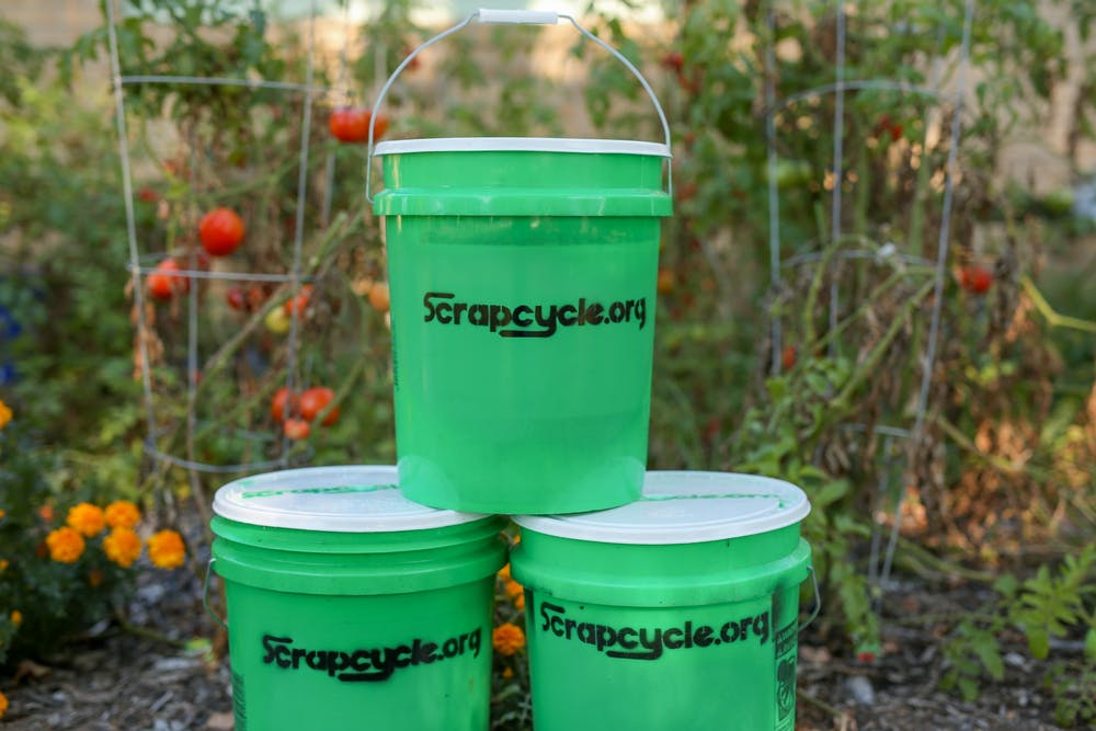 <p>Green ScrapCycle buckets sit in a pyramid in Muncie, Indiana. The composting program is volunteer-based and people who want to participate can sign up online and receive their own bucket within two weeks. <strong>Bob Mattax, Photo Provided</strong></p>