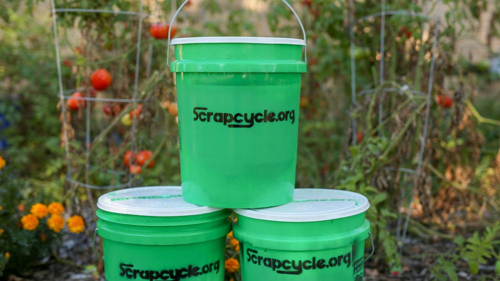 Green ScrapCycle buckets sit in a pyramid in Muncie, Indiana. The composting program is volunteer-based and people who want to participate can sign up online and receive their own bucket within two weeks. Bob Mattax, Photo Provided