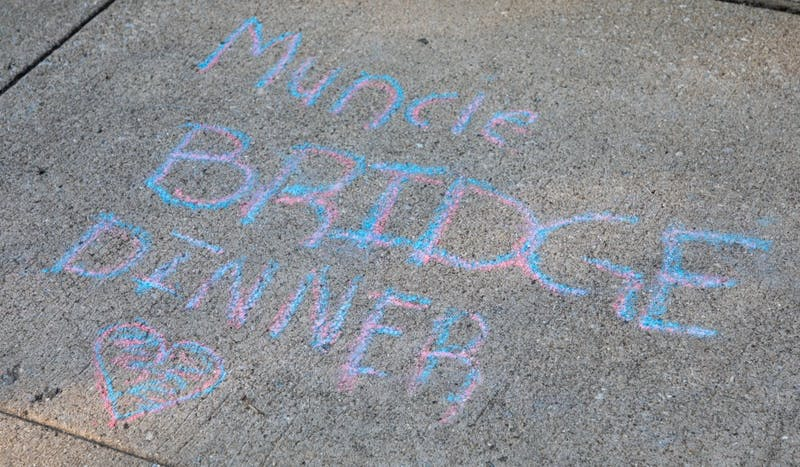 Chalk art drawn on the sidewalk at the Muncie Bridge Dinner Sept. 20 on the Washington St. Bridge. The annual Muncie Bridge Dinner had both food and music for participants. Chase Martin, DN.
