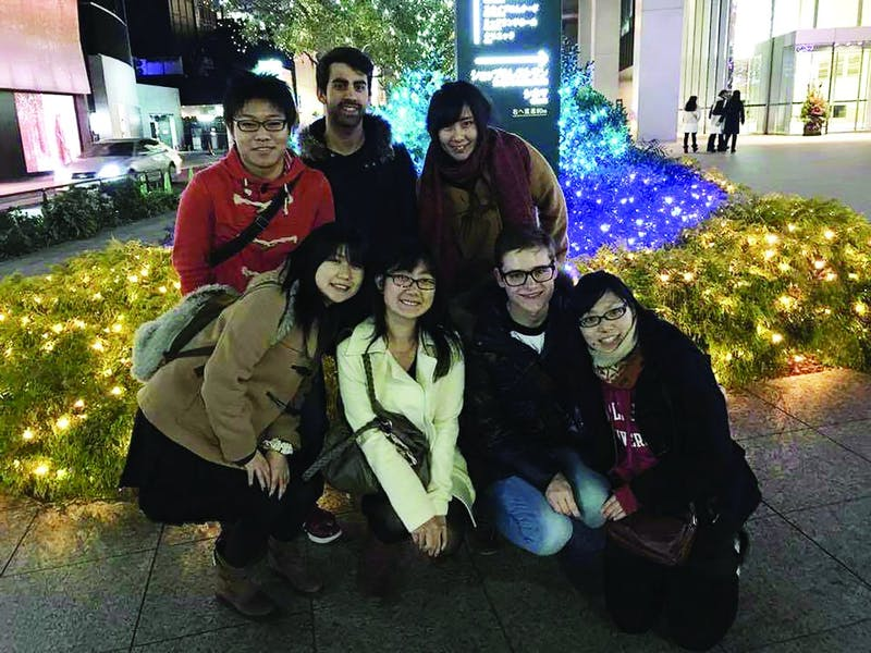 Ball State alumnus Conner Zelmer (second row center) spends time with his friends from Ball State in Tokyo, including Ai Shikano (front row left) and Jesse Taskovic (front row third from the left). Ai and Taskovic both pushed Zelmer to apply for the MEXT scholarship. Conner Zelmer, photo provided.