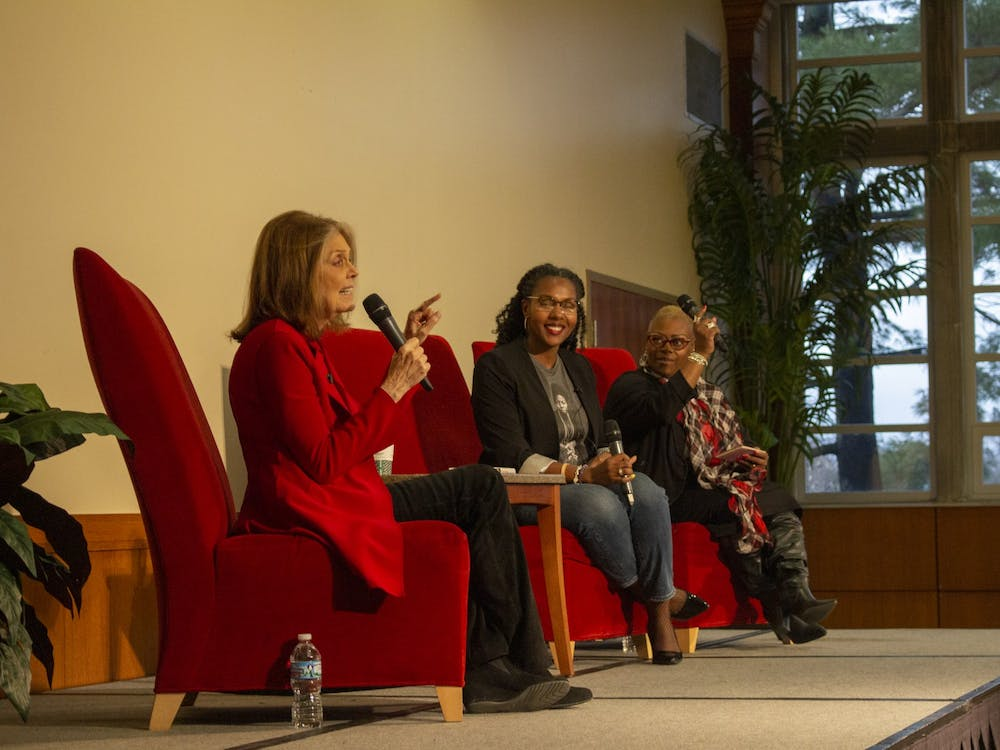 """WaTasha Barnes Griffin and Mia Johnson laugh along with the audience as Gloria Steinem answers questions about feminism, politics and intersectionality Dec. 2, 2019, in the L.A. Pittenger Student Center Ballroom. Steinem said she picked quotes for her new book """"The Truth Will Set You Free, But First It Will PIss You Off!"""" based off the ones she found herself repeating. Demi Lawrence, DN"""
