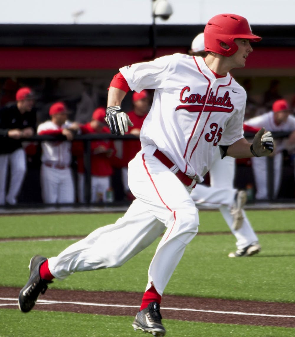 Matt Eppers, a junior outfielder for the Ball State Cardinals, rounds first base in the game against Dayton on March 18. DN PHOTO GRACE RAMEY