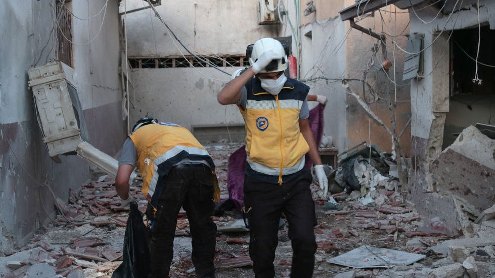 Members of Syria's Civil Defence service sift through the rubble at Al-Shifaa hospital following shelling of the rebel-held city of Afrin in northern Syria, on June 12, 2021. Shelling of the rebel-held city of Afrin in northern Syria killed at least 16 people, many of them when a hospital was struck, a war monitor said. (BAKR ALKASEM/AFP via Getty Images/TNS)