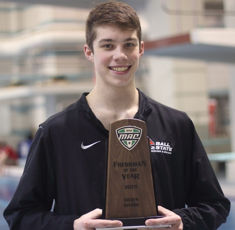 Freshman Hunter Ongay with the 2019 Mid-American Conference Freshman Diver of The Year Award at the 2019 MAC Swimming and Diving Championships March 7, 2019. Ongay is the first Cardinal to receive the award since Rachel Bertram for the women's team in 2017. Patrick Murphy, DN