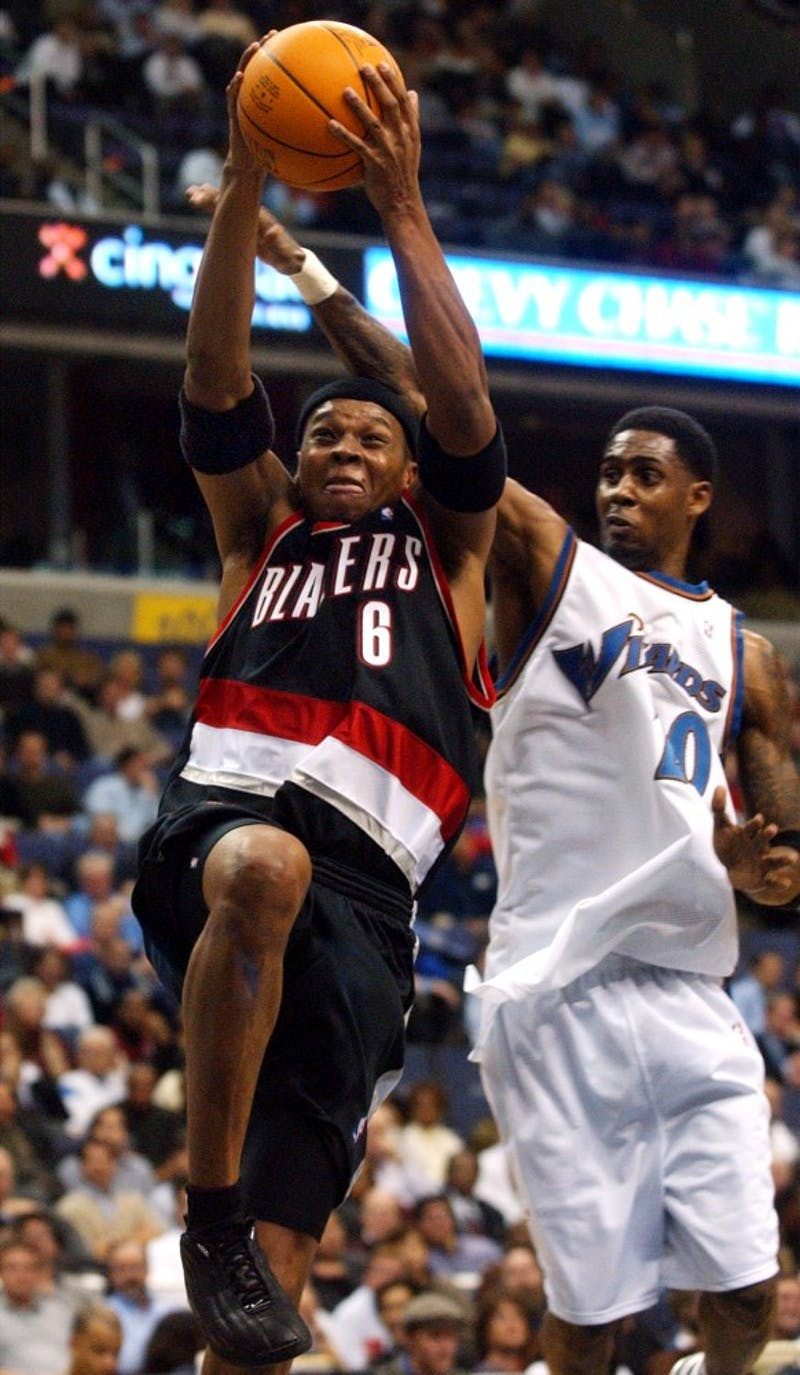 KRT SPORTS STORY SLUGGED: TRAILBLAZERS-WIZARDS KRT PHOTO BY GEORGE BRIDGES/KRT (December 10) WASHINGTON, DC -- Portland's Bonzi Wells (6) drives by Washington's Larry Hughes (20) in the second half of the Trail Blazers 98-79 victory Tuesday, December 10, 2002. (KRT) NC KD BL 2002 (Vert) (gsb)