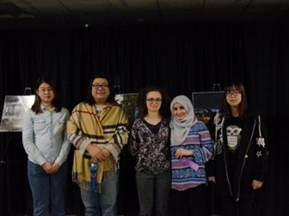 Five of the six winners of the International Photo Contest pose for photos after the ceremony Nov. 16, 2018. All of the submitted photos fell into three categories: Best Indiana Experience, International Culture and Places and U.S. sightseeing. Kamryn Tomlinson, DN.