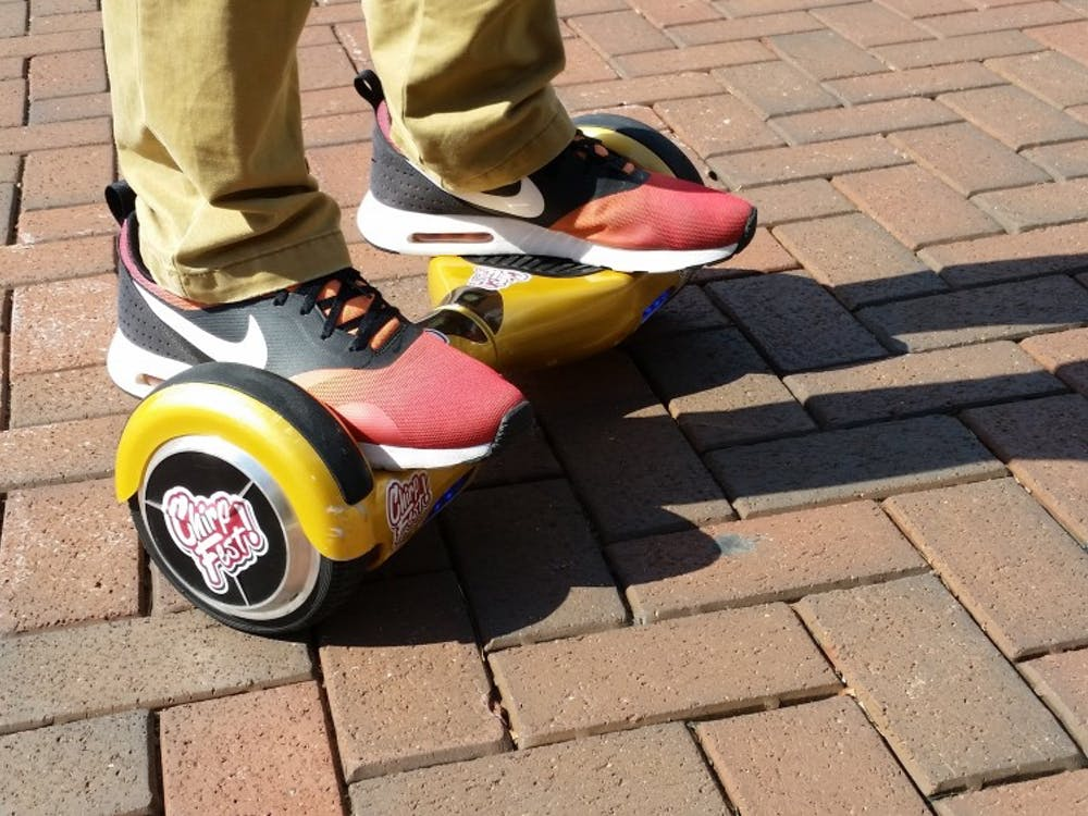 Recently, hoverboards, as they're commonly referred to, have been showing up around campus and are being sold by the people who organize ChirpFest. The boards operate like a Segway, but lack the pole. DN PHOTO ALEXANDRA SMITH