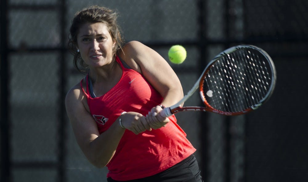 <p>Senior Julia Sbircea hits a backhand during her doubles match against IUPUI on Feb. 19, 2017. <strong>Emma Rogers, DN File</strong></p>