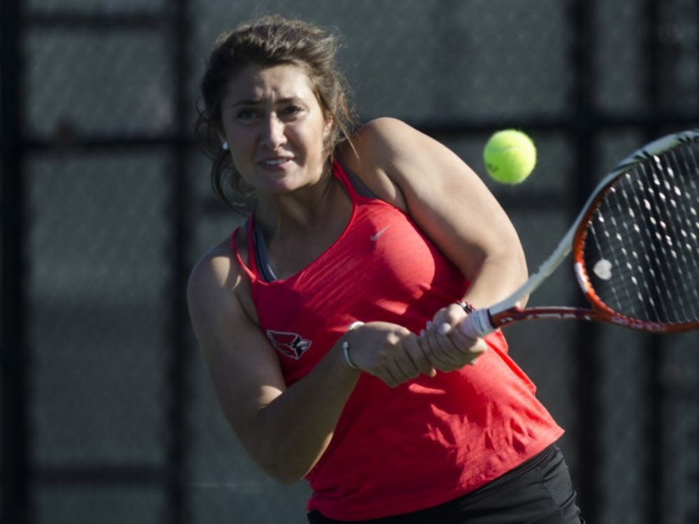 Senior Julia Sbircea hits a backhand during her doubles match against IUPUI on Feb. 19, 2017. Emma Rogers, DN File