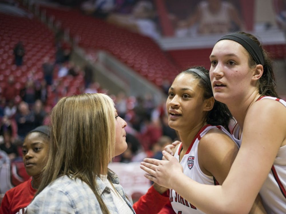 Senior guard Nathalie Fontaine and junior center Renee Bennett celebrate following theBall State women's basketball victory over Northern Illinois on March 2 at Worthen Arena. DN PHOTO BREANNA DAUGHERTY