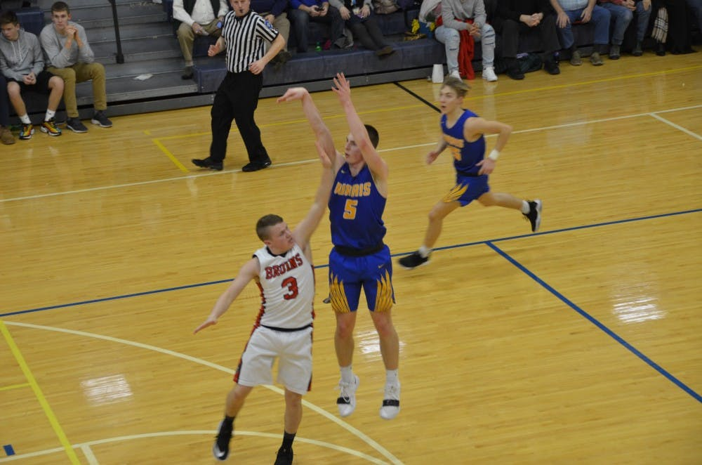 Burris senior Jackson Adamowicz shoots over a Blackford defender in a game against the Bruins on Feb. 21 at Ball Gymnasium. The Owls fell to the Bruins, 88-69. Jack Williams, DN