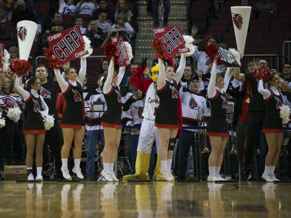 Members of the Ball State cheer squad attempt to rally the crowd at the start of the MAC semifinal game against Akron on March 10 at Quicken Loans Arena in Cleveland, Ohio. Breanna Daugherty // DN