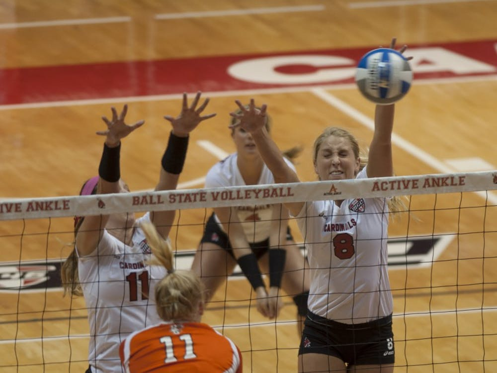 Senior middle hitter Mindy Marx jumps up for a block against Bowling Green State University on Oct. 25 at Worthen Arena. DN PHOTO MATT McKINNEY